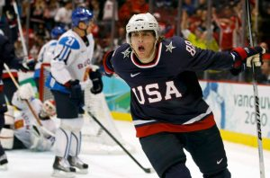 Patrick of the U.S. celebrates after scoring the fourth goal against Finland during the first period of their men's ice hockey playoff semifinals game